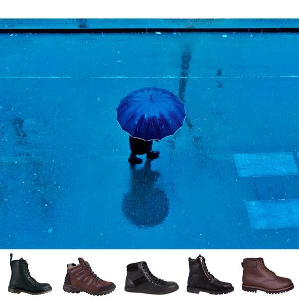 Bild Mensch mit Schirm im Regen